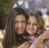 Portrait of a mother and her young daughter, close-up stock photography