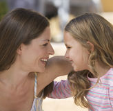 Portrait of a mother and her young daughter, close-up Stock Images