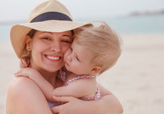 Portrait of mother holding her bay girl at beach Royalty Free Stock Photos