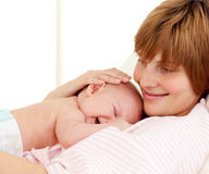 Portrait of a mother holding her newborn baby Royalty Free Stock Photography