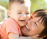 Portrait of a mother hugging her son Royalty Free Stock Images