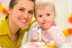 Portrait of mother and kid eating birthday cake Royalty Free Stock Images