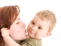 Portrait of mother kissing her son stock image