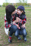 Portrait of mother and little son look at together stock photography