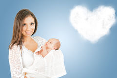 Portrait of mother with newborn baby  with cloud background. Portrait of  mother with newborn baby  with heartshaped cloud background copy space Stock Image