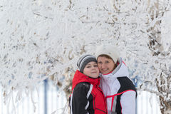 Portrait of mother and son in cold  winter day Stock Image