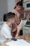 Portrait of a mother and son doing homework Royalty Free Stock Image