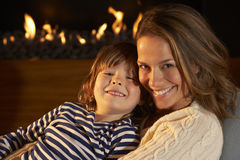 Portrait mother and son by firelight Royalty Free Stock Photography
