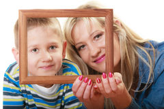 Portrait of mother and son holding photo frame Stock Image