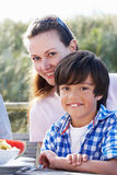 Portrait Of Mother And Son Hugging Outdoors Stock Photography