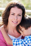 Portrait Of Mother And Son Hugging Outdoors Stock Image