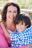 Portrait Of Mother And Son Hugging Outdoors Royalty Free Stock Image