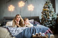 Portrait of mother and son on New Year`s background. royalty free stock image
