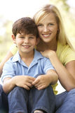 Portrait Of Mother And Son In Park Stock Photos