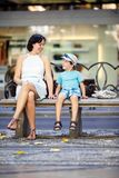 Portrait of mother and son sitting outdoors Stock Photography
