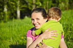 Portrait of mother and son. Spring portrait of mother and son on Mother's Day. Family walk in the park Royalty Free Stock Image