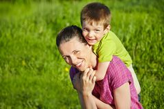 Portrait of mother and son. Spring portrait of mother and son on Mother's Day. Family walk in the park Royalty Free Stock Photography