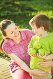 Portrait of mother and son. Spring portrait of mother and son on Mother's Day. Family walk in the park Royalty Free Stock Photos