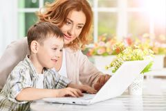 Mother and son using laptop Stock Image