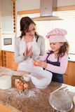 Portrait of a mother teaching her daughter how to bake Stock Images