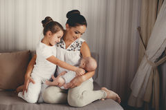 Portrait of a mother with two children at home Royalty Free Stock Image
