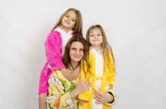 Portrait of a mother and two daughters in bath robes Stock Photos