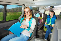 Portrait of mother and two sons sitting in the car Royalty Free Stock Photo
