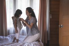 Portrait mother wearing clothes for daughter stock photos