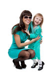 Portrait of mother and young daughter hugging Royalty Free Stock Images