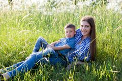 Portrait of a mother with a young son for a walk in the Woods stock images