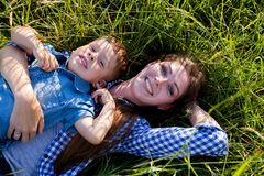 Portrait of a mother with a young son for a walk in the Woods royalty free stock images