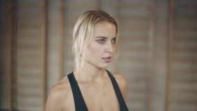 Portrait of motivated woman running on treadmill machine in sport club. Closeup serious woman practicing on run machine in gym. Focused girl jogging in fitness stock video footage