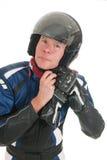 Portrait motor biker putting on his helmet Stock Photography