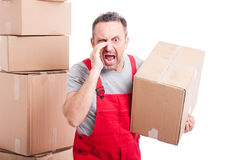 Portrait of mover man holding box and screaming loud Stock Photos