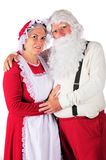 Portrait of Mr. and Mrs. Santa. Three-quarter length portrait of Mr. and Mrs. Santa in their at-home attire. On a white background stock image