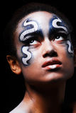 Portrait of mulatto girl with face-art. Portrait of mulatto girl with space face-art, body-art Royalty Free Stock Images