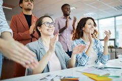 Business People Clapping in Meeting stock photo