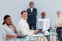 Portrait of a multi-ethnic business team at work. In the office royalty free stock photography