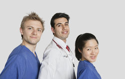 Portrait of multi ethnic medical team over gray background Stock Photography