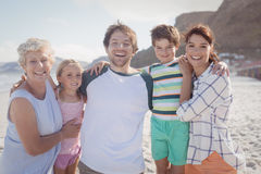 Portrait of multi-generated family embracing at beach Royalty Free Stock Photos