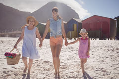 Portrait of multi-generated family walking at beach Royalty Free Stock Images