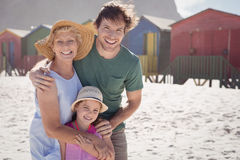 Portrait of multi-generation family embracing at beach Royalty Free Stock Photography
