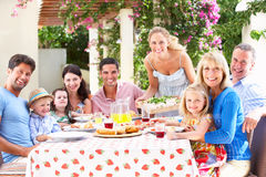 Portrait Of Multi Generation Family Meal. Outside Smiling Stock Images