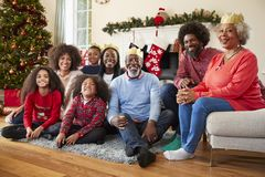 Portrait Of Multi Generation Family Sitting In Lounge At Home On Christmas Day stock photography