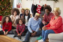 Portrait Of Multi Generation Family Sitting In Lounge At Home On Christmas Day royalty free stock photos