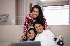 Portrait of multi-generation family smiling together. At home stock photography