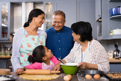 Portrait of multi-generation family standing together in domestic kitchen Stock Images
