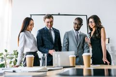 Portrait of multicultural smiling business people having business meeting. In office royalty free stock images