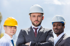 Portrait of multiethic group of professional architects in hard hats Royalty Free Stock Photo