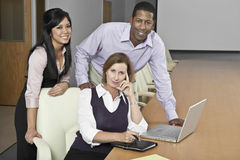 Portrait Of Multiethnic Businesspeople With Laptop Stock Photos